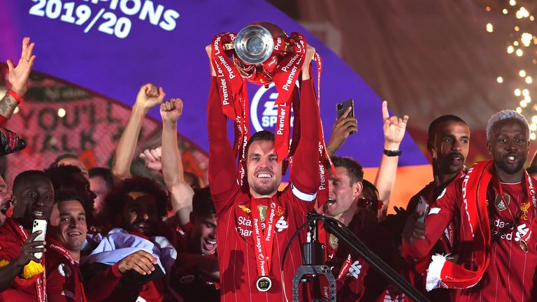 Jordan Henderson lifts Liverpool's first Premier League trophy