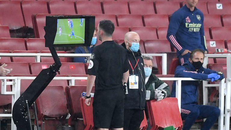 Chris Kavanagh used the pitchside monitor before sending off Arsenal's Eddie Nketiah