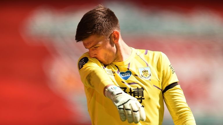 Nick Pope was booked for time-wasting late on at Anfield