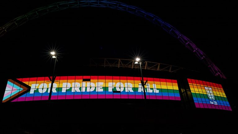 Wembley Stadium was lit up in the Pride flag colours earlier this week