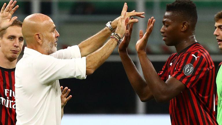 Goalscorer Rafael Leo celebrates with Stefano Pioli at full-time