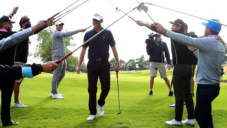 Renato Paratore wins the British Masters and celebrates with his mother via a Sky Sports iPad before being given a guard of honour by several players as he left the green