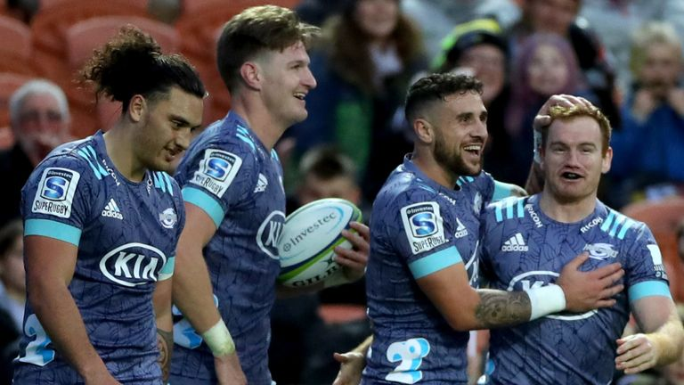 Hurricanes celebrate scoring their first try against the Chiefs