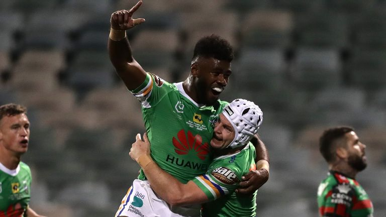 Try-scorers Semi Valemei and Jarrod Croker celebrate during Canberra's win over Souths