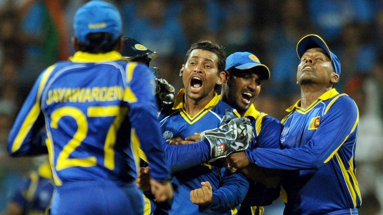 Sri Lanka celebrate the wicket of India's Virat Kohli during 2011 Cricket World Cup final