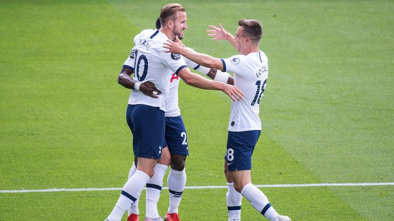 Harry Kane celebrate with teammates Giovani Lo Celso and Harry Winks after scoring against Crystal Palace