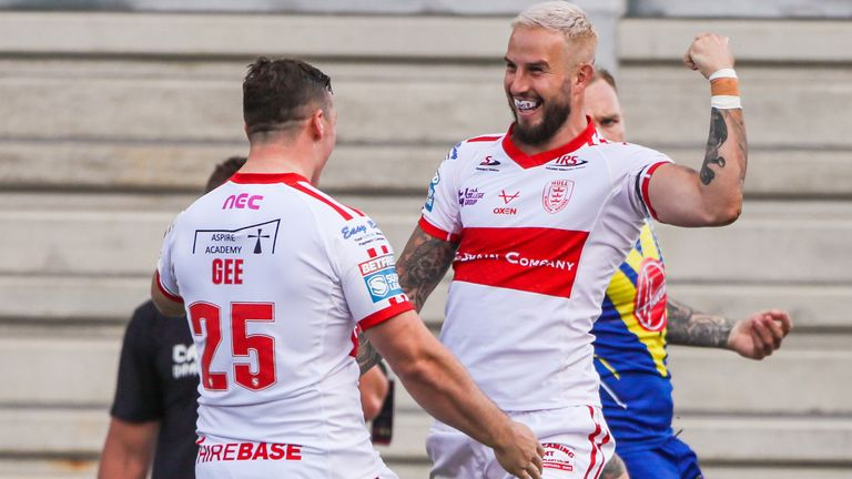 Hull KR's Ben Crooks celebrates his try with Matthew Gee
