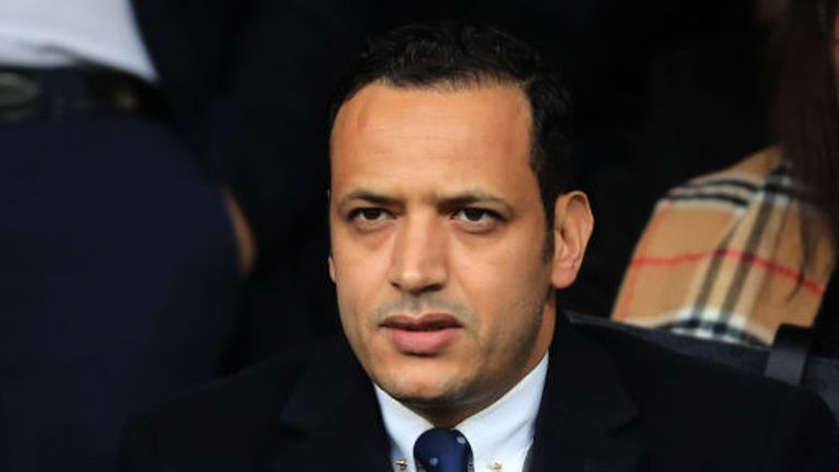 An arbitrator has ruled Oldham chairman Abdallah Lemsagam did not breach the terms of the manager's contract