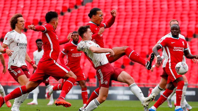 Virgil van Dijk kicks the ball to score a goal which was disallowed