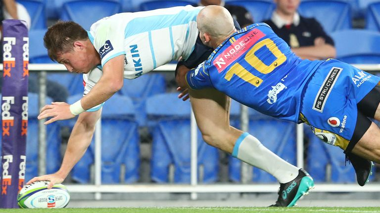 Alex Newsome scores a try against the Western Force