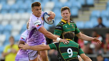 Henry Slade of Exeter Chiefs makes a break past Henry Taylor of Northampton Saints