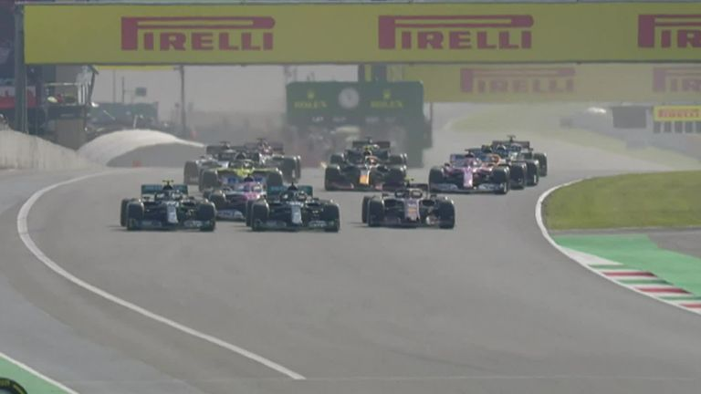 Mercedes' Lewis Hamilton gets back ahead of Valtteri Bottas around the outside into Turn One at the Tuscan GP for his 90th F1 win