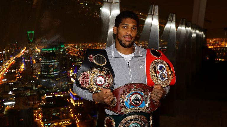 Joshua holds the IBF, WBA and WBO belts