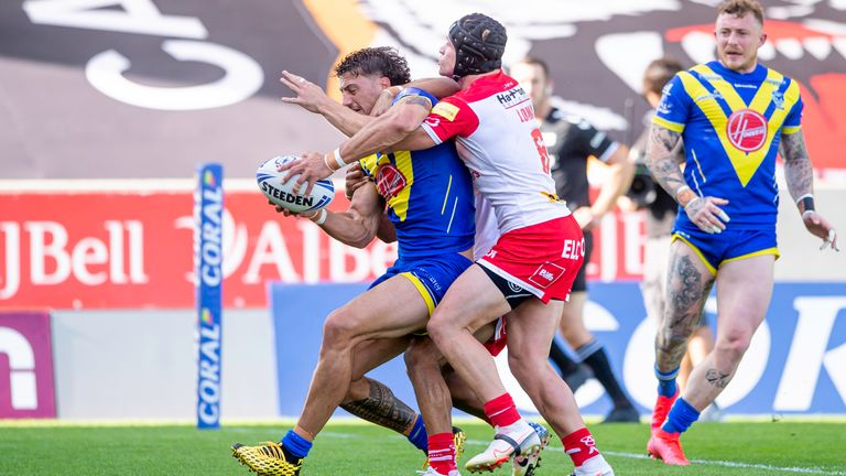 Anthony Gelling fends off the tackle of Jonny Lomax to score a try