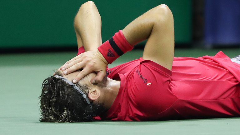 Dominic Thiem lies down on his back in disbelief after winning the US Open