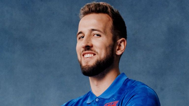 England captain Harry Kane models the new blue away England shirt (Pic courtesy of England and Nike)