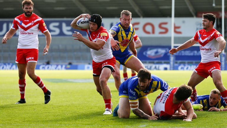 St Helens' Jonny Lomax breaks through to score their first try