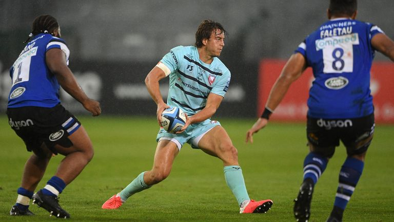 Lloyd Evans of Gloucester Rugby runs with the ball