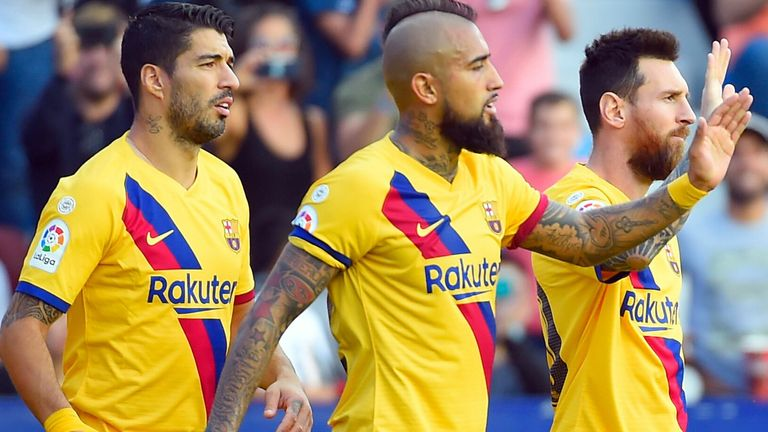 Lionel Messi's team-mates Luis Suarez and Arturo Vidal want him to stay at Barcelona