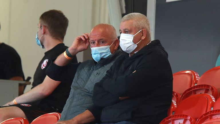 Warren Gatland (R) looks on with Lions logistics manager Alan Phillips