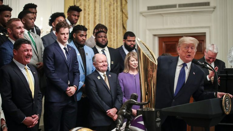 Trump speaks during an event to honour this year's NCAA football champions Louisiana State University Tigers in the White House in January