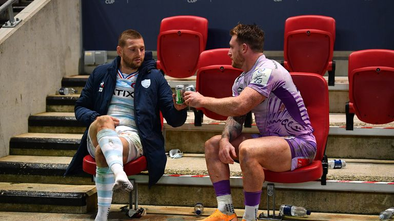 Russell (L) and Stuart Hogg share a beer after the Champions Cup final
