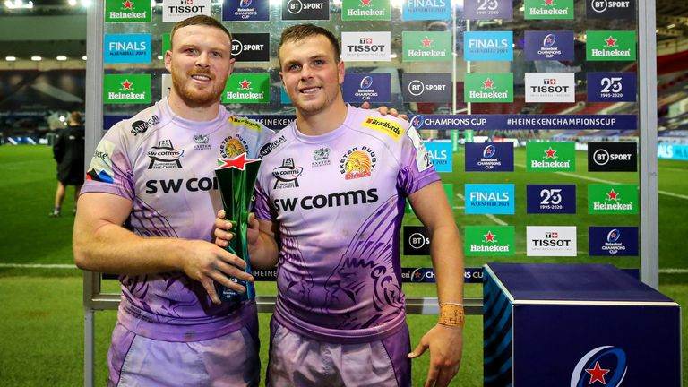 Sam Simmonds (left) hands the man-of-the-match award to his brother Joe following their Champions Cup victory