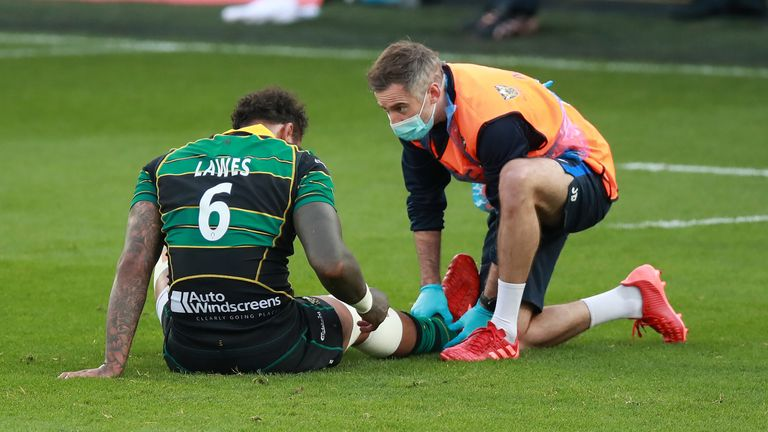 Courtney Lawes receives medical attention after injuring his ankle against Sale