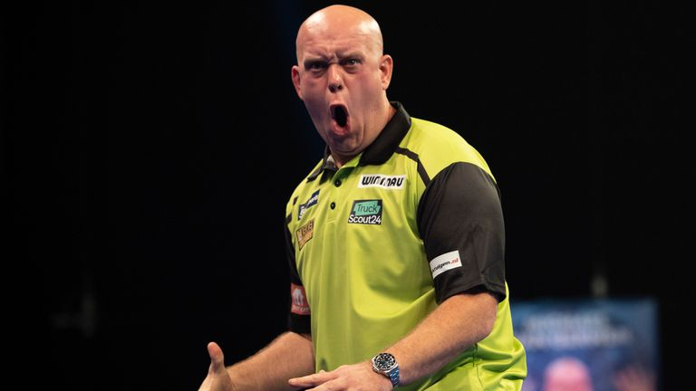 Michael van Gerwen is into the last eight at the World Grand Prix after beating Devon Petersen in Coventry