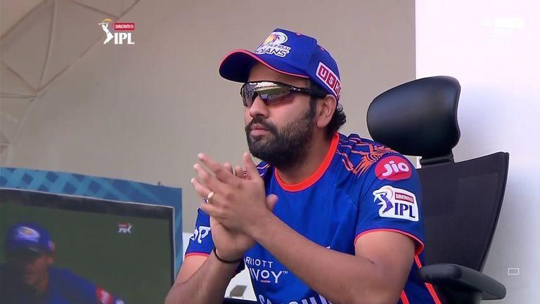 Injured Mumbai Indians captain Rohit Sharma watched on happily