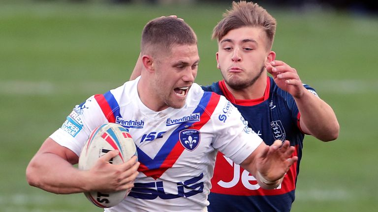 Ryan Hampshire on the charge for Wakefield against Hull KR