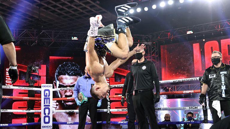 Lopez celebrates with a backflip