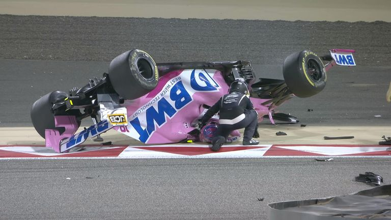 Lance Stroll's Racing Point car is flipped over after a collision with Daniil Kvyat on the restart in Bahrain.