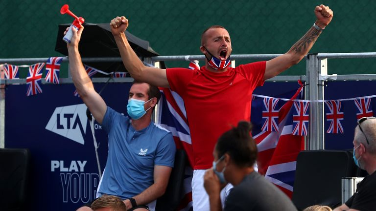 Andy Murray with the airhorn and Dan Evans cheer on their team during the Battle of the Brits event this summer