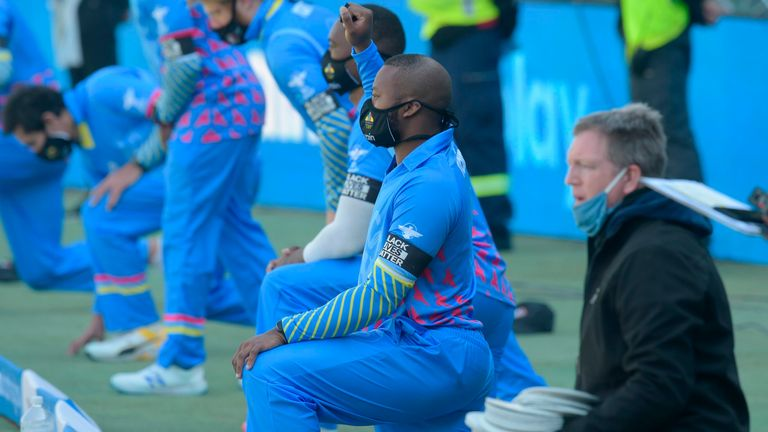 South African players and officials take a knee in solidarity with the global Black Lives Matter movement ahead of the 3TC Solidarity Cup cricket match