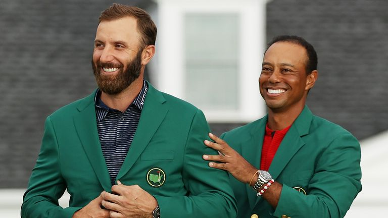 Dustin Johnson was presented with the Green Jacket by 2019 champion Tiger Woods