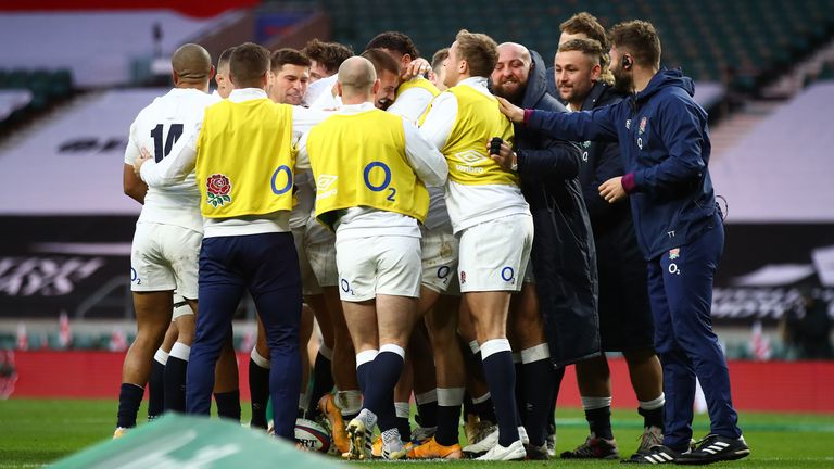 England celebrate May's opening try at a deserted Twickenham