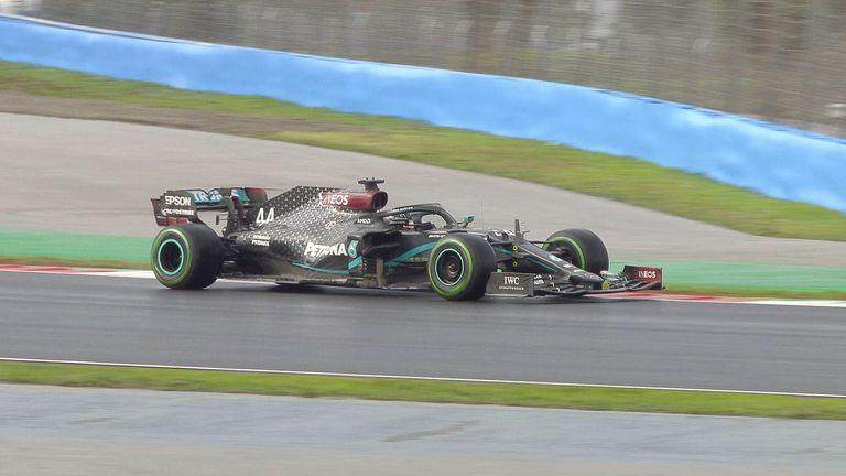Lewis Hamilton passes Sergio Perez into Turn 12 to take the lead at the Turkish GP
