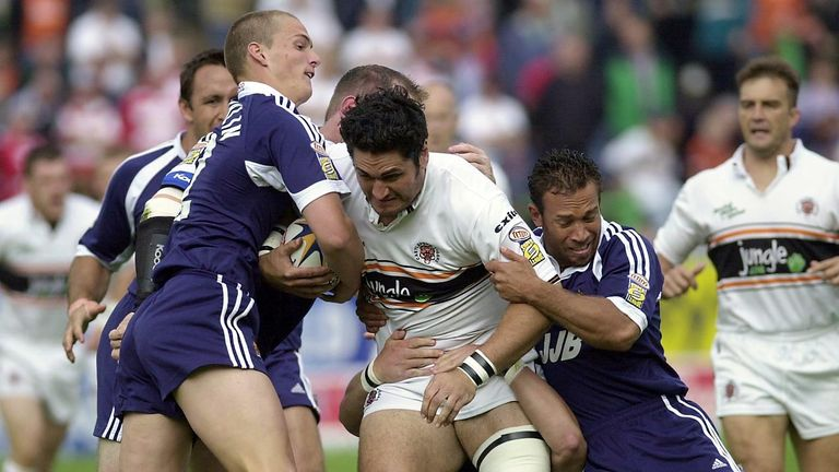 Sean O'Loughlin and Adrian Lam tackle Castleford's Michael Smith in 2002