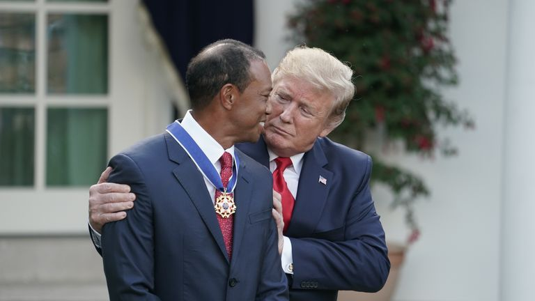 Trump gives golfer and business partner Tiger Woods the Medal of Freedom in May 2019 in a Rose Garden ceremony at the White House