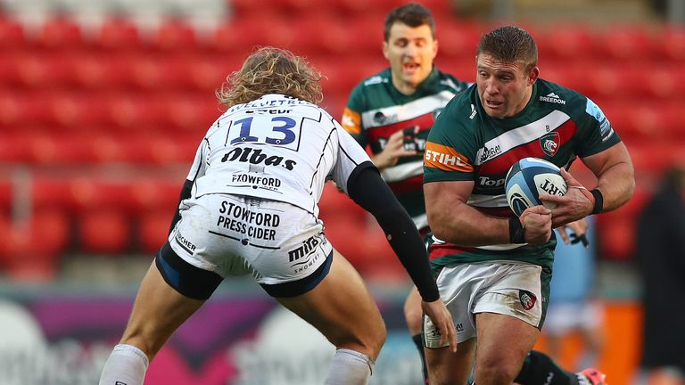 Tom Youngs looks to beat the tackle from Billy Twelvetrees