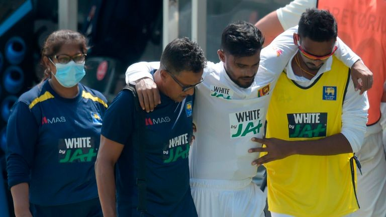 Sri Lanka's Dhananjaya de Silva comes off the field after suffering a hip injury during the first test against South Africa.