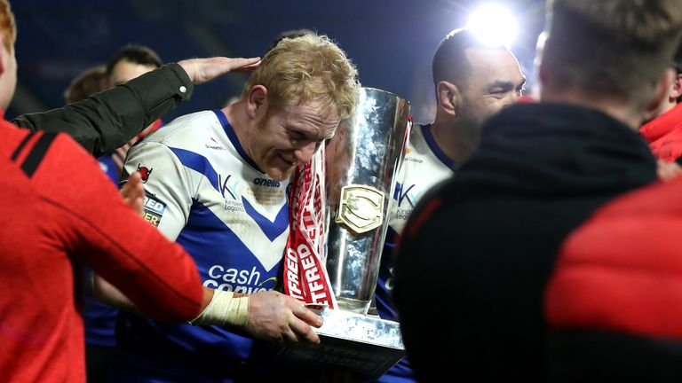 James Graham celebrates with the trophy after St Helens' Grand Final triumph