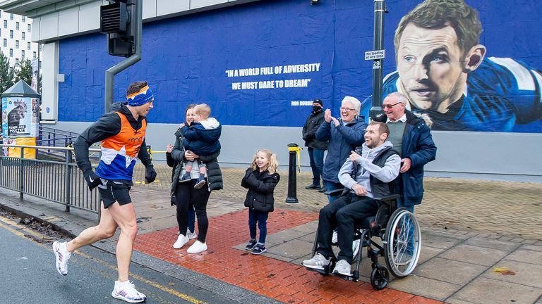 Kevin Sinfield MBE runs to greet Rob Burrow on day 5 of his seven marathons in seven days fundraising challenge.