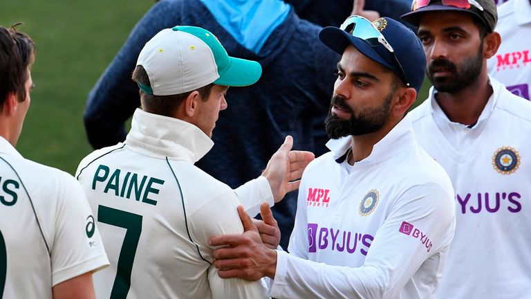 Tim Paine and Virat Kohli after Australia's eight-wicket win over India, in which the tourists were shot out for 36