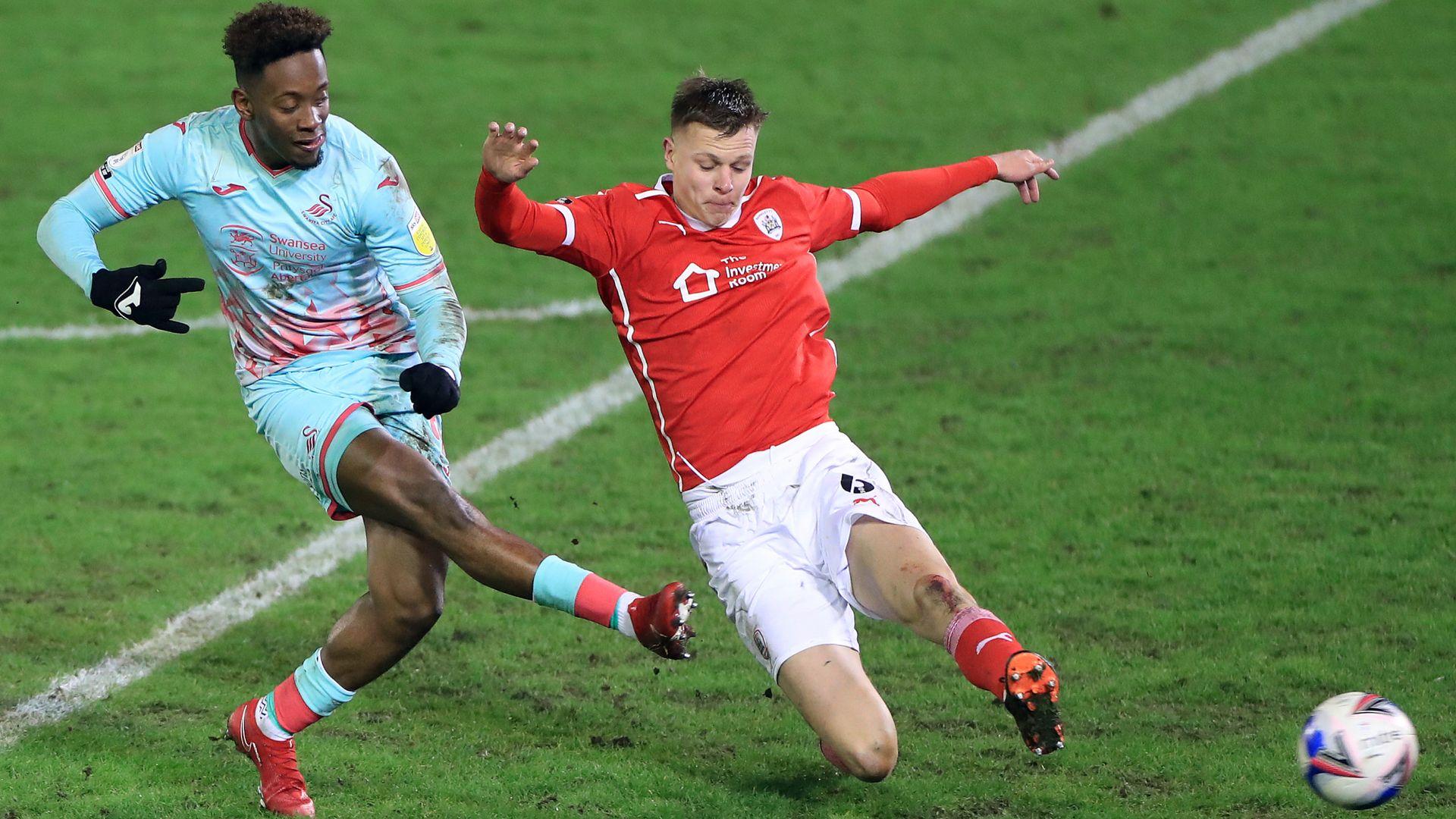 Swansea battle to edge Barnsley