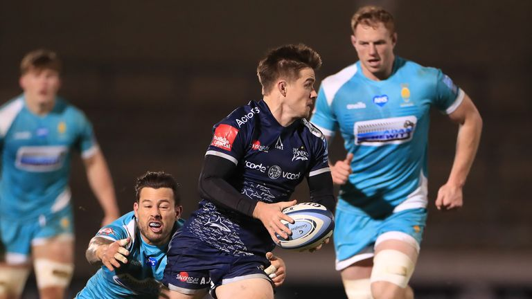 AJ MacGinty looks to offload out of the tackle