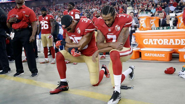 San Francisco quarterback Colin Kaepernick (right) kneels during the national anthem in September 2016