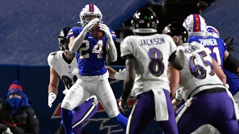 Buffalo Bills cornerback Taron Johnson intercepts a pass by Baltimore Ravens quarterback Lamar Jackson (AP Photo/Adrian Kraus)
