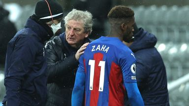 Roy Hodgson consoles Wilfried Zaha after he was forced off through injury at Newcastle